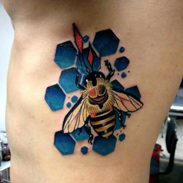 The Blue Honeycomb. This blue honeycomb and the yellow bee makes the vibrant combination for the tattoo.