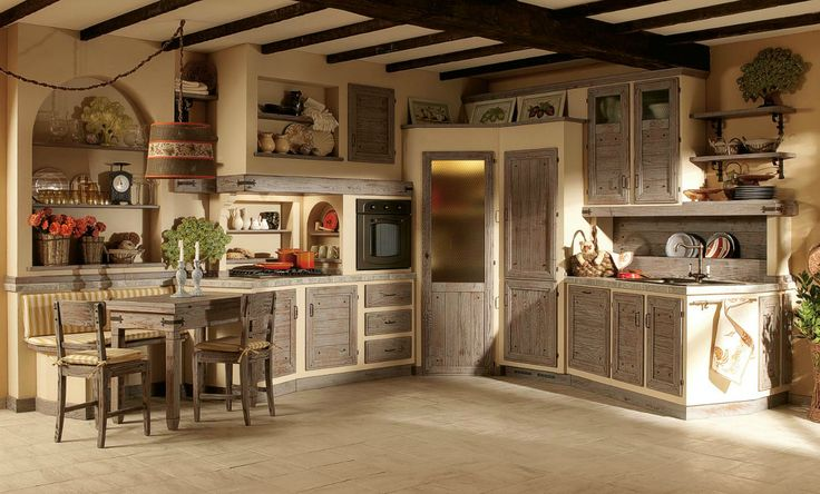 L shaped kitchen with reclaimed wood cabinets and breakfast nook
