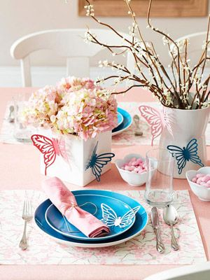 Set a light and cheery table with symbols of spring, such as our pretty, delicate paper butterflies! For more spring table ideas: http://www.midwestliving.com/homes/entertaining/spring-centerpieces/