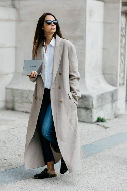 Team a long trench coat with a fresh white blouse and jeans this season…