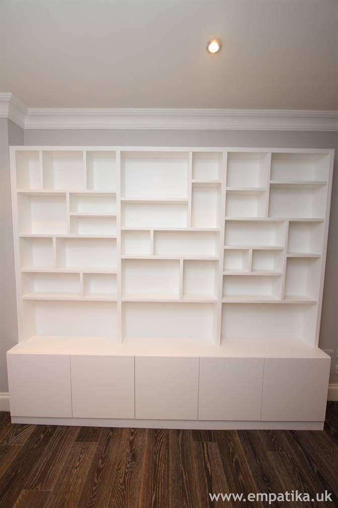 Storage cupboards with random style contemporary shelving on top built from scratch in London by Empatika https://www.Empatika.ukA sculpture in itself