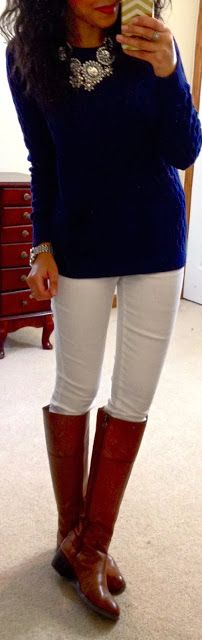 navy sweater, white jeans, riding boots.