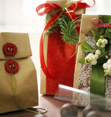 What a great way to decorate humble brown bags as fantastic gift bags. Use buttons, wool, strips of craft paper left overs with a pinch of creativity.