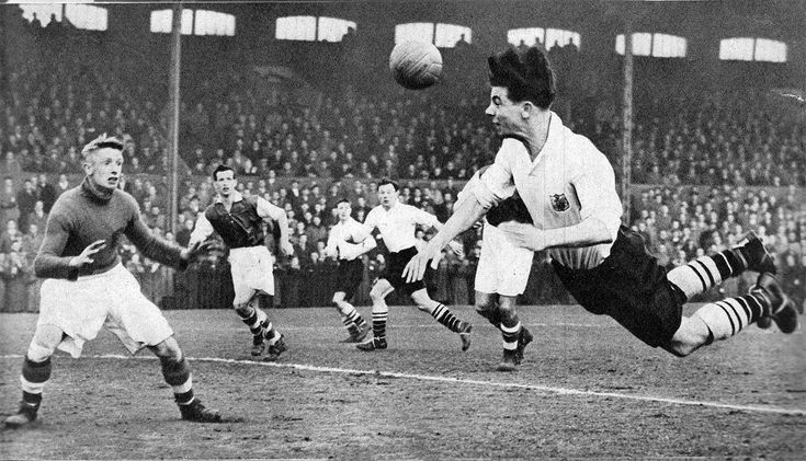 19th March 1955. Fulham inside forward Johnny Haynes attempts a flying header against Rotherham United, at Craven Cottage.