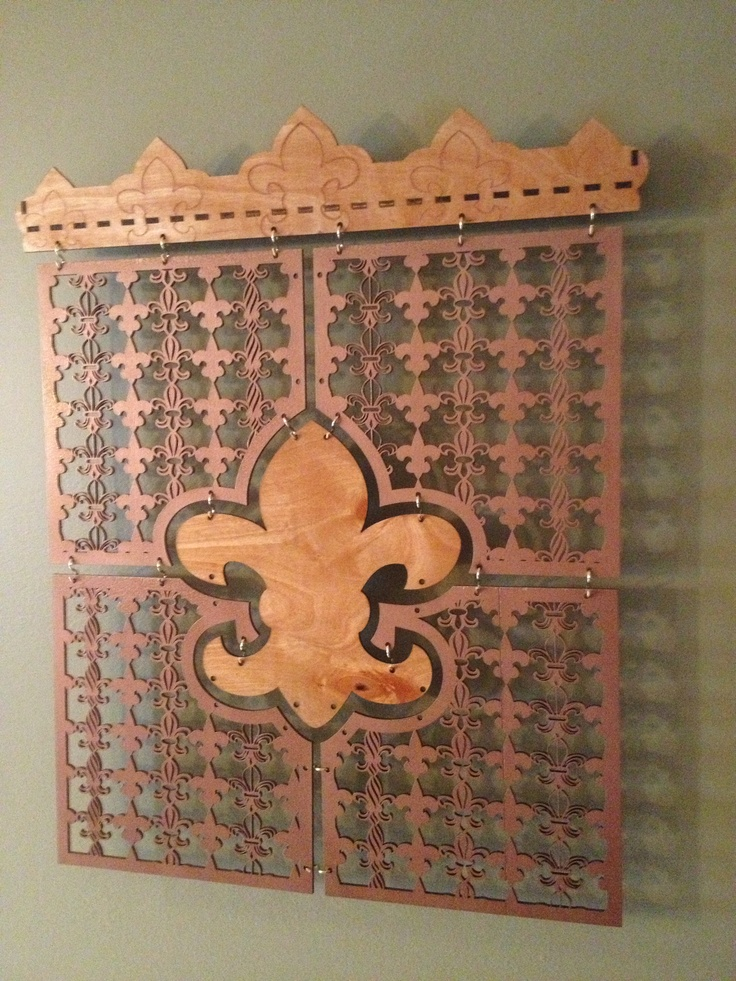 "Fleur De Lis Collage Wall Panel. This is a 6 piece design with Solid Brass Hardware. It measures about 28"" x  24"" $169.99 www.fithianlaserphotographics.com"