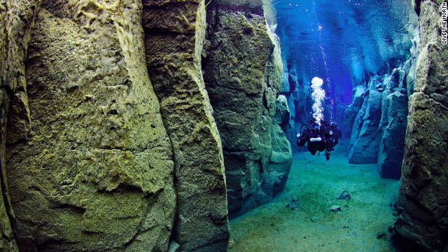 Scuba Diving in Iceland between the Eurasian and North American tectonic plates.