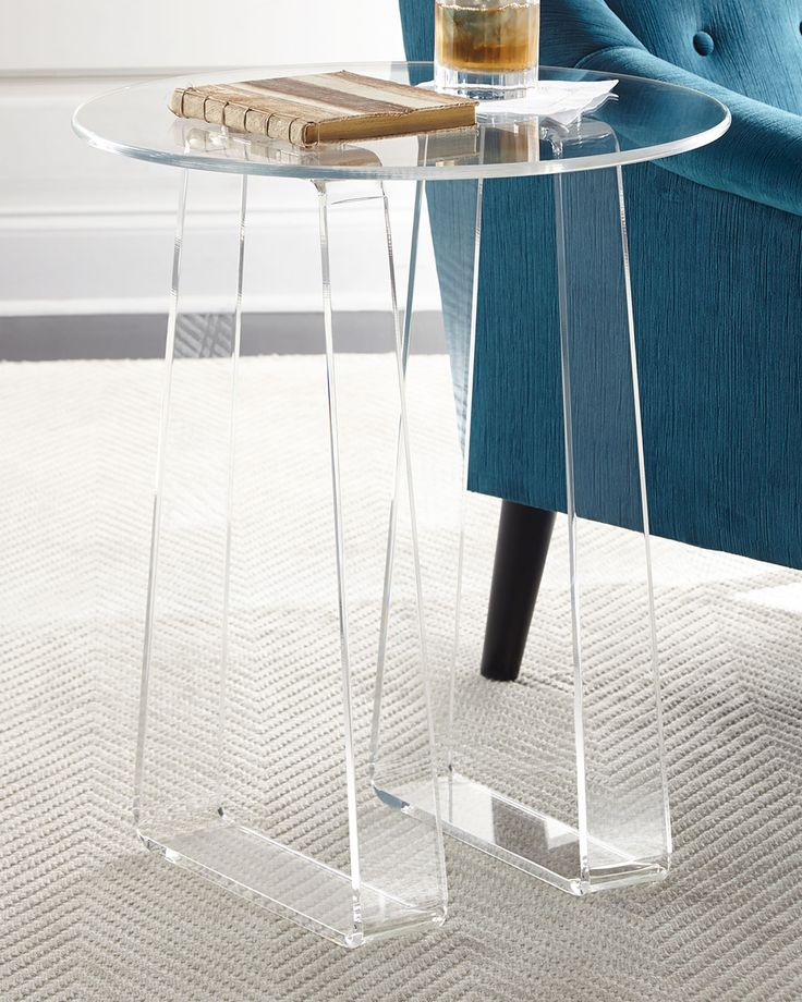 "Handcrafted side table. Clear acrylic. 20""Dia. x 24""T. Assembly required. Imported. Boxed weight, approximately 21 lbs."