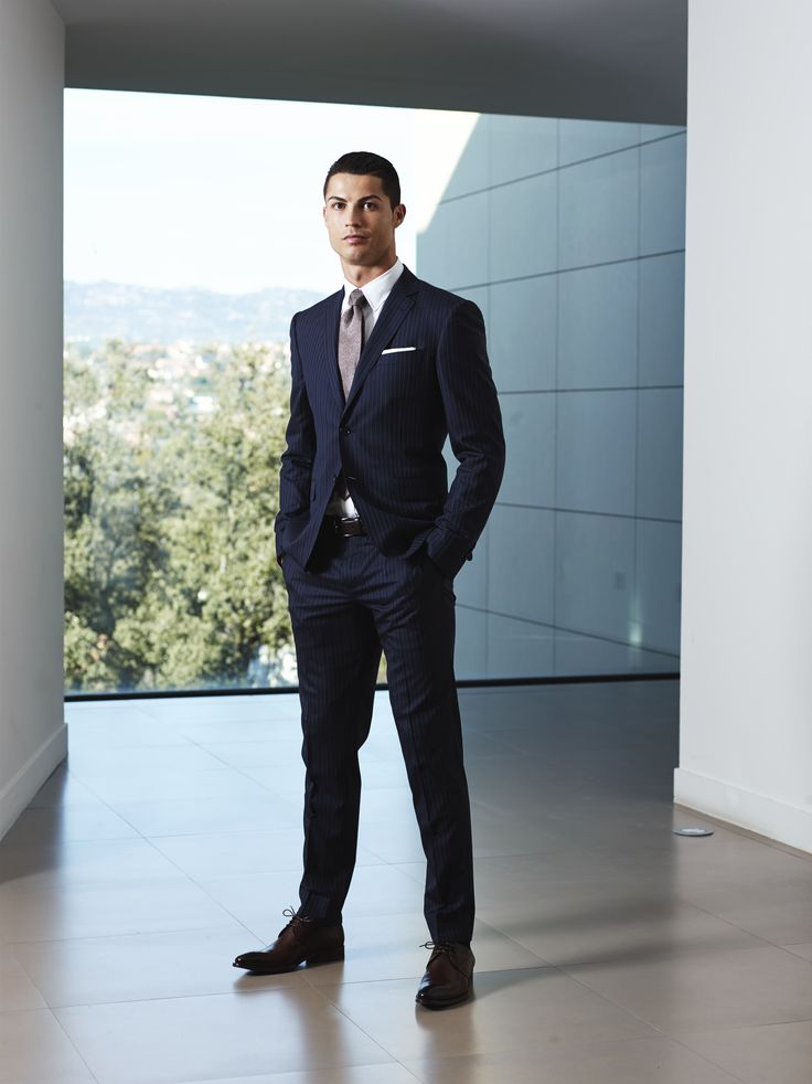 Cristiano Ronaldo in a Sacoor Brothers blue suit