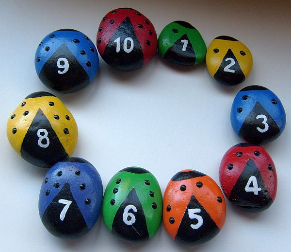 Painted stone ladybugs - a fun way to learn (or teach) colors and numbers.