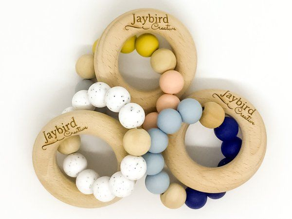 Jaybird Creative Classic Teethers. Consists of a silicone bead ring interlocked with a beech wood ring to sooth those aching baby gums