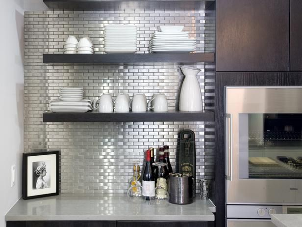 The espresso bar area is highlighted by a shining stainless steel backsplash, which mimics the finish of the appliances in the kitchen.