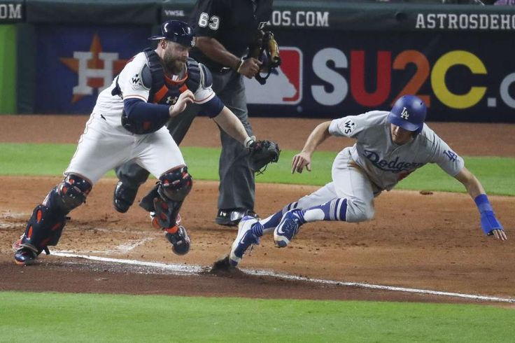 October 28, 2017:  Game 4 of World Series.  Los Angeles Dodgers and Houston Astros, 6 to 2, Dodgers. Houston Astros catcher Brian McCann (16) chases down Los Angeles Dodgers catcher Austin Barnes (15), preventing a run with an out during the sixth inning as the Houston Astros take on the Los Angeles Dodgers in Game 4 of the World Series at Minute Maid Park Saturday, Oct. 28, 2017 in Houston. Photo: Michael Ciaglo/Houston Chronicle