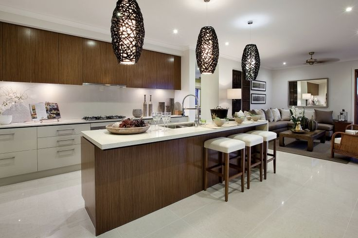 This Balinese inspired kitchen features medium toned timber cabinetry and over-sized natural pendant lighting. Traditional stone carved decor completes the private sanctuary style.