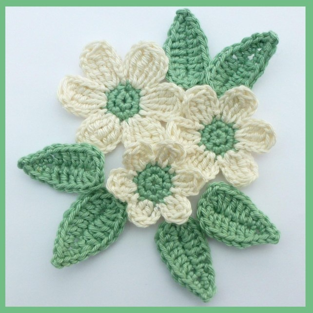 3 cream crochet flowers and 6 green leaves, appliques and embellishments £3.00