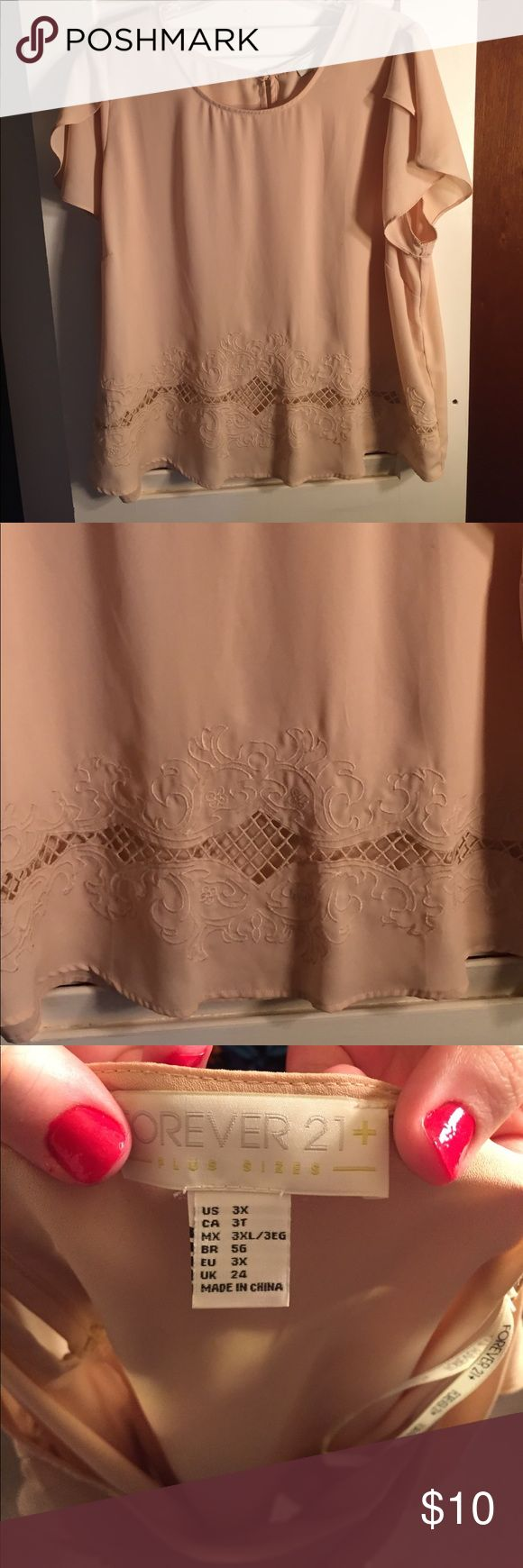 Cream colored Blouse EUC, only worn once. Pale pink short sleeve top with cut out at bottom. Charlotte Russe Tops Blouses