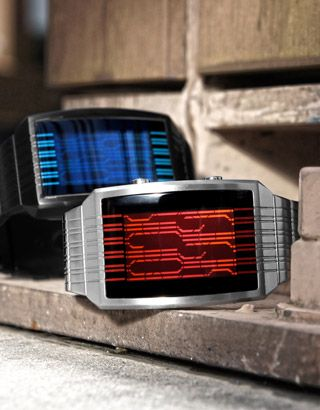 Kisai Online Red LCD & Blue LCD    A futuristic watch design with continuous vertical lines, Kisai Online from Tokyoflash Japan uses a built in accelerometer to reveal the digital time.    Kisai Online includes time, date and alarm functions. Made of stainless steel, this design is available in black or silver in a choice of three cool LCD colors; natural, blue or red.