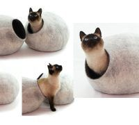 The cat cocoon bed has been handmade from sheep wool felt. It is durable, easy to clean and comfortable for your pet. Soft, warm modern, beautiful design.