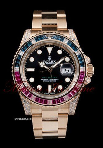 Rolex GMT-MASTER II YELLOW GOLD BAGUETTE DIAMOND, SAPPHIRE & RUBY $69,000 #Rolex #watches #chronograph 40mm 18K yellow gold case set with 76 diamonds