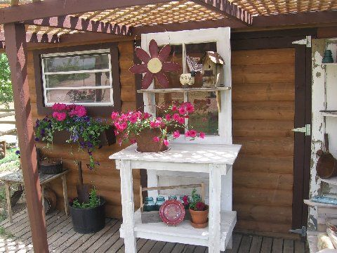 The potting benches are made from old doors. I saw this idea in a Country Sampler magazine a few years back. The sunflower next to one of the benches is made from an old hog feeder pan, an old metal fence stake and old garden hose.""