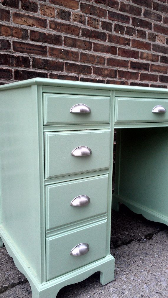 Old desk revamp. I love the light mint color with the silver pulls.