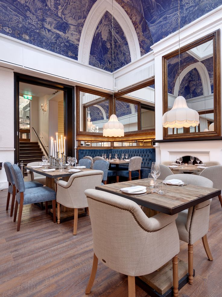 The Grade II Listed Building Of Iberica Leeds Is Sympathetically Adorned In Dark Wood Panelling And Rich Blue Hues Designed By Lazaro Rosa Violan
