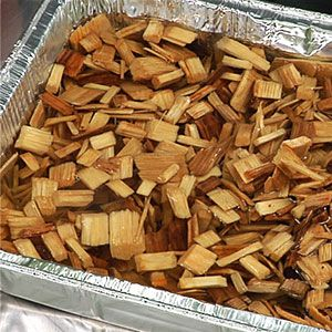 Learn how to use wood chips to smoke food on the grill. Wood chips add a smoky flavor to the fire and your food.