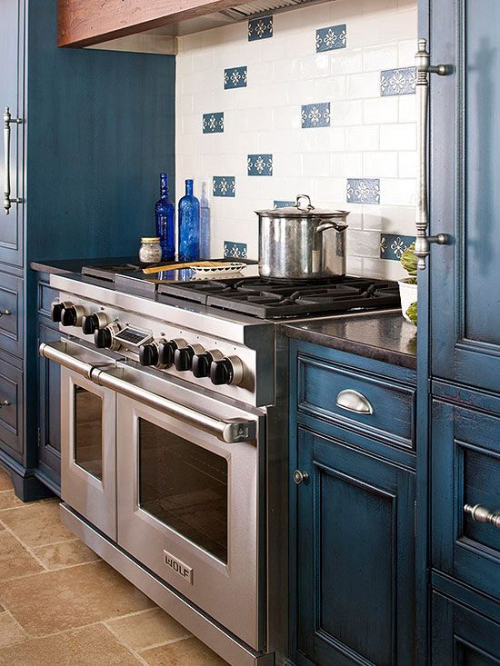 By mixing blue accent tiles in with the white background, the kitchen