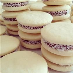 "The word alfajor comes from the Arab word for ""honeycomb."" There are different styles of alfajor around the world including Spain, Argentina, Peru, Uruguay, and Mexico.   In Argentina a typical alfajor consists of two sweet butter cookies (or biscuits) with dulce de leche, mouse, or cream sandwiched between, and then dipped in chocolate."