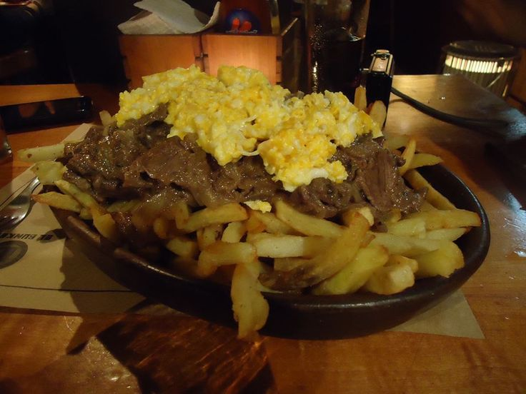 Even though its name comes from a Peruvian district called Chorrillos, the Chorrillana, which ingredients are french fries, beef, sliced onions and fried eggs, is one of the Chilean's favourites to eat with friends. Certainly you'll need a bit of help! Come to Chile and learn Spanish and about our culture with us. www.natalislang.com