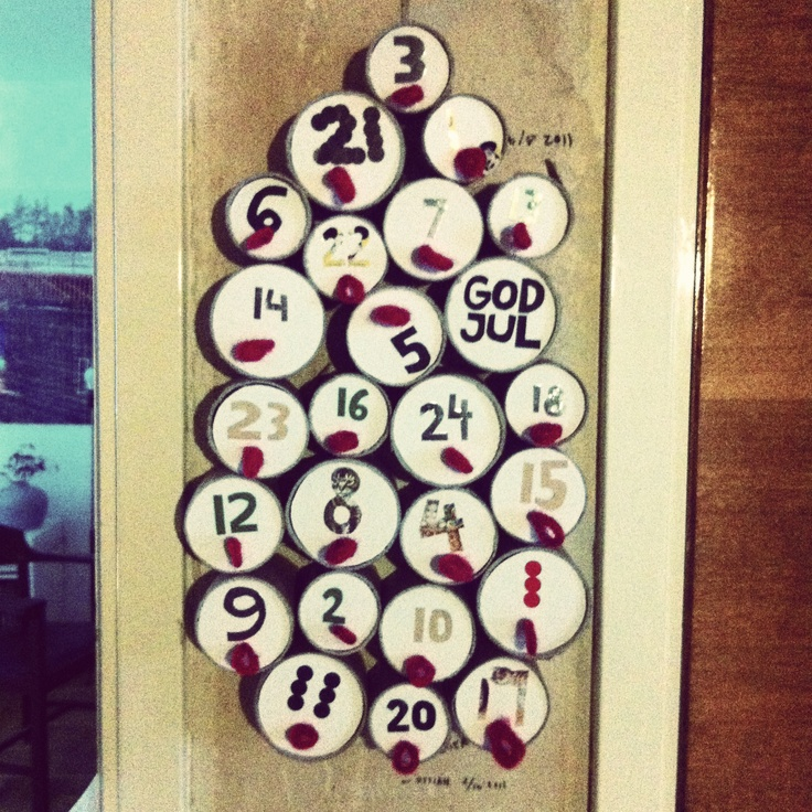 Advent calendar for 2012. Made from paper tubes, cardboard, yarn, colored paper and old stickers.