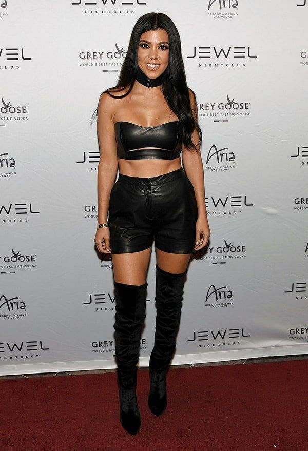 Kourtney Kardashian partied it up in Las Vegas on Saturday, May 21, showing off her incredibly toned abs and legs in a black leather crop top and thigh-high boots — read more