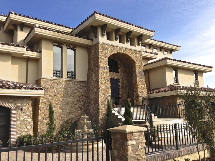 Custom Stone And Stucco Tuscan Home Designed And Built By