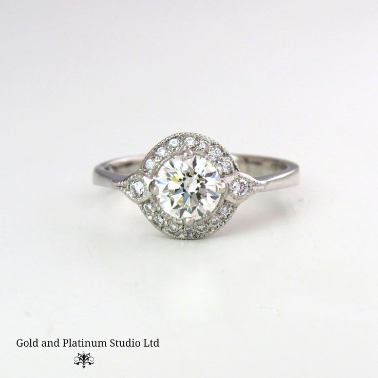 A stunning ring, designed in the studio and handmade by Mike. Set with breath taking diamonds in such a beautiful design.