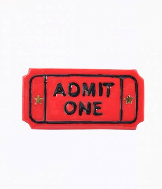 Got your ticket, dear? Heres a gorgeous red resin brooch that has us checking dates for the next state fair. Featuring engraved embellishments with the words, Admit One and gleaming gold stars on either side. Secured by a silver bar pin so youll never