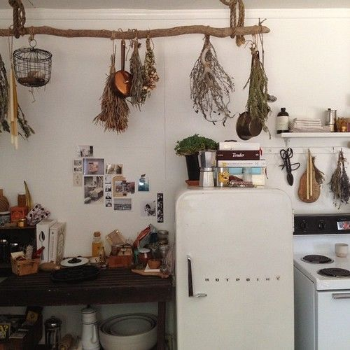Kitchen with hanging branch for drying herbs.  I have been meaning to do this forever but had no bar.  What a perfect solution!