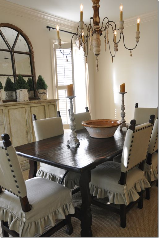 Dining room chairs, slipcovers on seats with upholstered top using large nail head tacks.