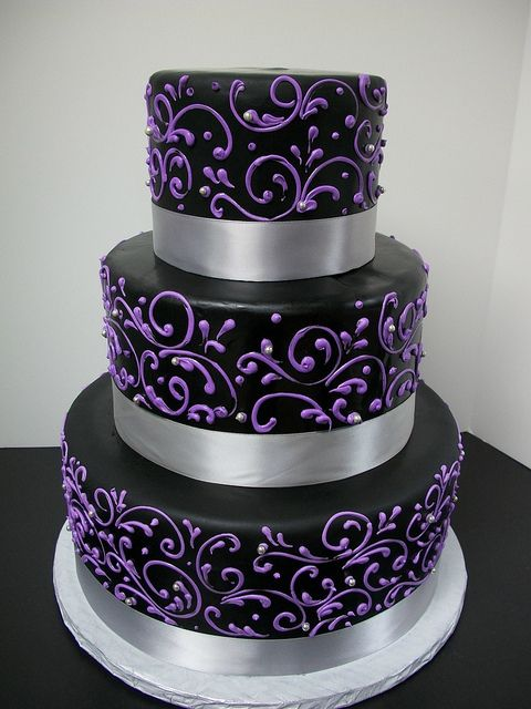 Black with Purple Scrollwork Wedding Cake - Love this
