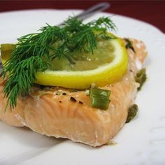 """Garlic Salmon I """"I have never cooked salmon before was pleasantly surprised how easy this recipe was and was very tasty. My whole family enjoyed it very much."""""""