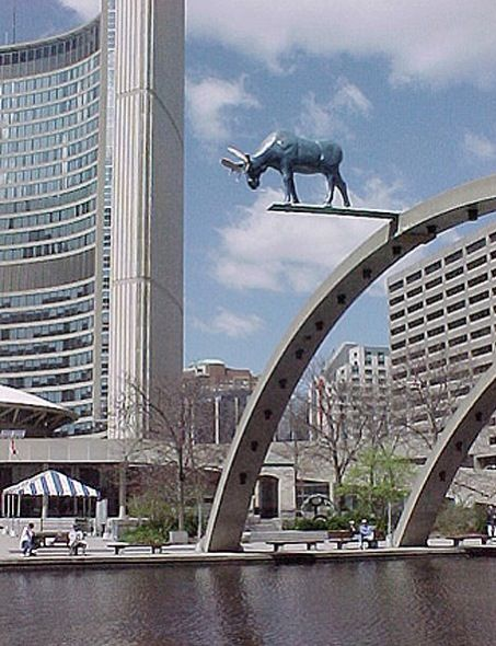 The ( not so new) Toronto City Hall . In the forefront Nathan Philips Square . A public wading pool in summer, and skating rink in winter . The Moose I don't recall .