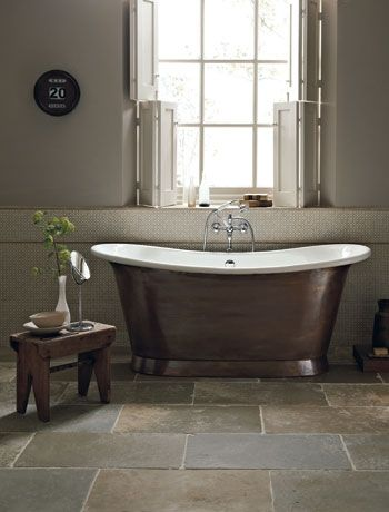 Brass Roll-top tub + blinds... SO elegant