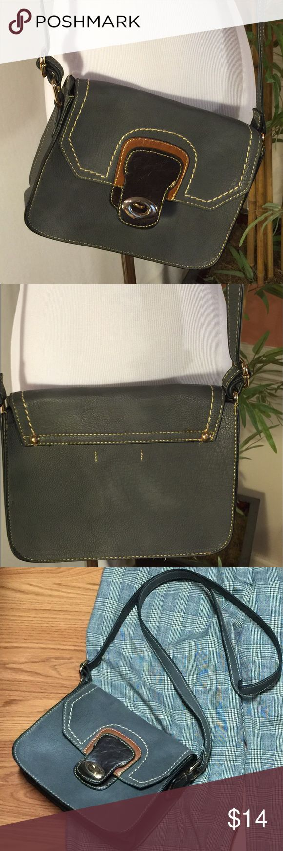 Wilson's Leather  Grey Leather Crossbody Purse This purse is in Excellent Used Condition. I think I only used it once. It's small. Great for a day trip or somewhere you don't want to carry a big bag. Wilsons Leather Bags Crossbody Bags