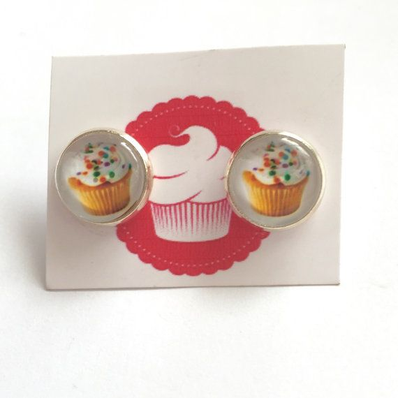 Handmade cupcake stud earrings. Glass domes on silvertone settings.  3 varieties available: -Vanilla sprinkles -Strawberry -Cherry with