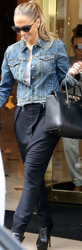 Who made Jennifer Lopez's cat sunglasses and black leather handbag that she wore…