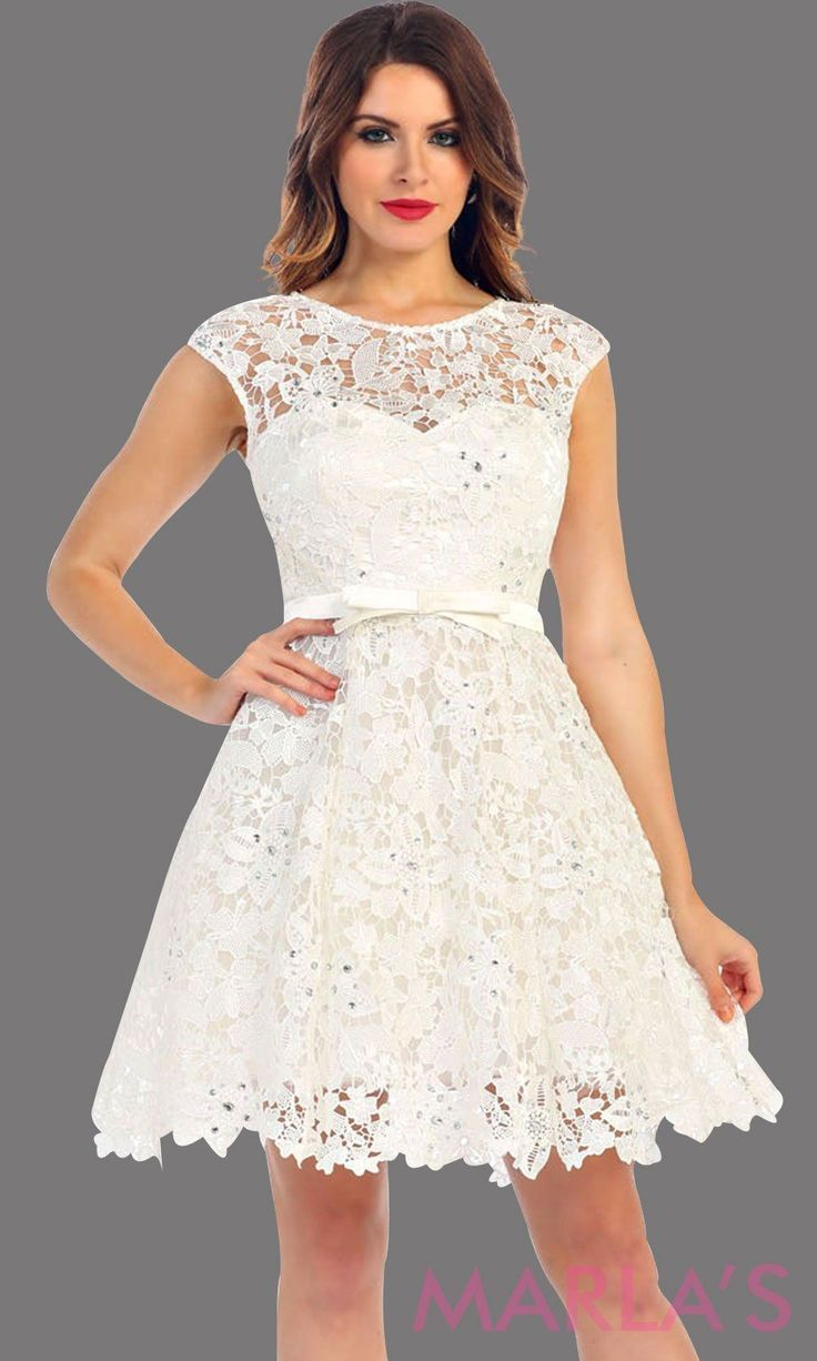 51490795148 Short white lace high neck dress with a satin bow. This white dress has a  flowy a line skirt. Its perfect for grade 8 g…
