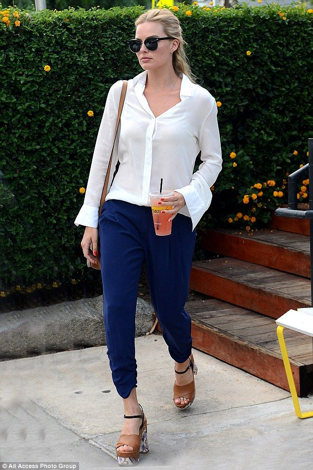 Cool in cobalt: Margot looked stunning in her ensemble of white shirt and blue loose fitte...