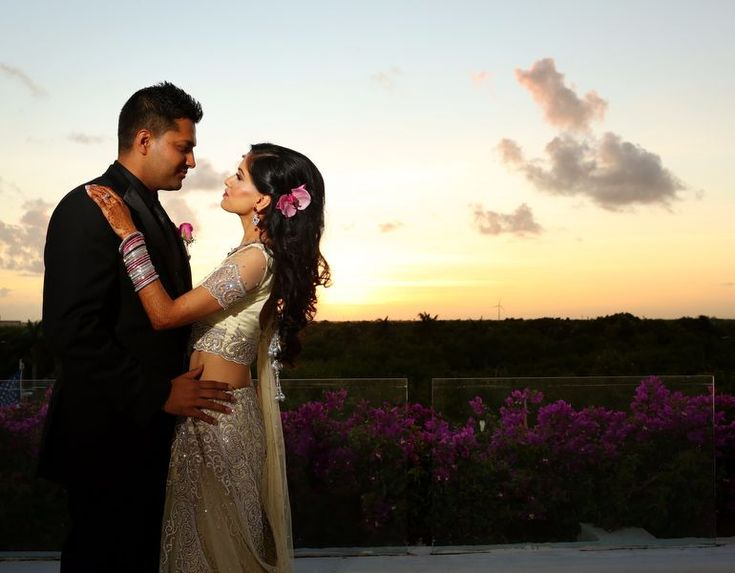 Sunset portrait of Indian bride and groom at Moon Palace Cancun #destinationwedding