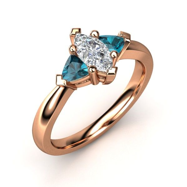 The Tatiana Ring, a marquise-cut three-stone ring. Customized in diamond, London blue topaz, and rose gold. #engagementring #marquisecut