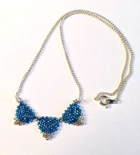 """An Elegant Hand Beaded Triangle """"Bunting"""" Necklace in Blue and Silver by LetsGetBusyBeading on Etsy"""