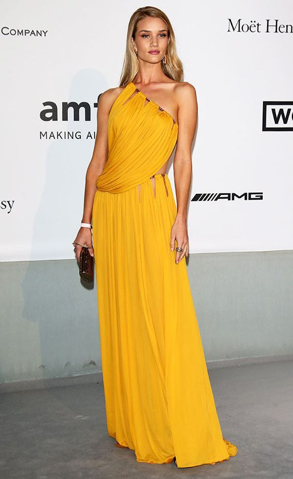 Sunny Yellow DressisTrendingat#Cannes2014 Rosie Huntington Whiteley in Emilio Pucci golden chain, cutout and draped details yellowgown during #Cannes Film Festival 2014 #fashion