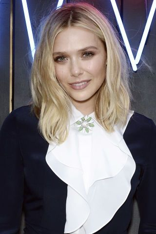 Consider the change of seasons your call to action to freshen up your hair with long layers, razored ends or a daring pixie: Elizabeth Olsen